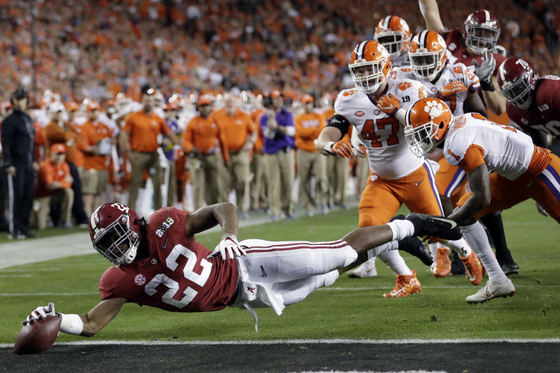 FILE - In this Jan. 7, 2019, file photo, Alabama's Najee Harris reaches for the end zone during the first half the NCAA college football playoff championship game against Clemson, in Santa Clara, Calif. Najee Harris has been a presence in Alabamas backfield pretty much since he arrived as one of the nations top recruits. Now, he's finally the lead runner. (AP Photo/David J. Phillip, File)