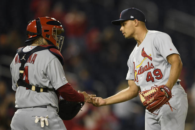 St. Louis Cardinals relief pitcher Jordan Hicks (49) celebrates with catcher Yadier Molina (4) after a baseball game against the Washington Nationals, Monday, April 29, 2019, in Washington. (AP Photo/Nick Wass)