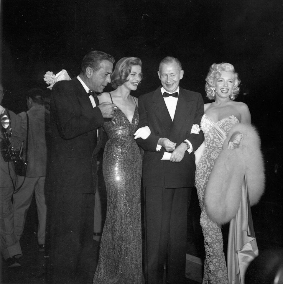 <p>Humphrey Bogart, Lauren Bacall, and Marilyn Monroe arrive at the Los Angeles film premiere of <em>How To Marry A Millionaire</em> in 1953. </p>