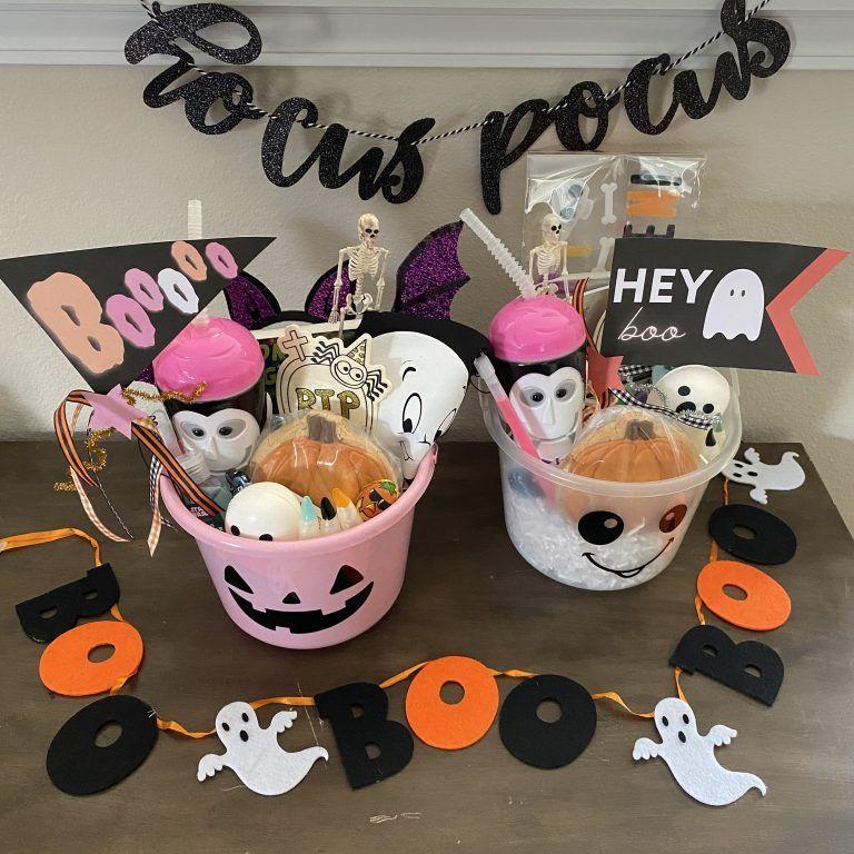 """<p>What's an awesome addition to a <em>Hocus Pocus</em> basket? In addition to all the fun stuff you can find in this photo, you can add an <a href=""""https://go.redirectingat.com?id=74968X1596630&url=https%3A%2F%2Fwww.etsy.com%2Flisting%2F822331903%2Fi-put-a-spell-on-you-mini-album&sref=https%3A%2F%2Fwww.goodhousekeeping.com%2Fholidays%2Fhalloween-ideas%2Fg34288815%2Fspooky-basket-ideas%2F"""" rel=""""nofollow noopener"""" target=""""_blank"""" data-ylk=""""slk:&quot;I Put a Spell On You&quot; mini album"""" class=""""link rapid-noclick-resp"""">""""I Put a Spell On You"""" mini album</a>! </p><p><a href=""""http://hellomissmartha.com/2020/09/30/create-a-kids-halloween-boo-basket/"""" rel=""""nofollow noopener"""" target=""""_blank"""" data-ylk=""""slk:See more at Hello Miss Martha »"""" class=""""link rapid-noclick-resp""""><em>See more at Hello Miss Martha »</em></a></p>"""