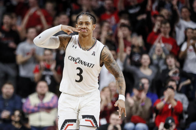 Cincinnati's Justin Jenifer reacts after scoring during the second half of the team's NCAA college basketball game against Connecticut, Saturday, Jan. 12, 2019, in Cincinnati. (AP Photo/John Minchillo)