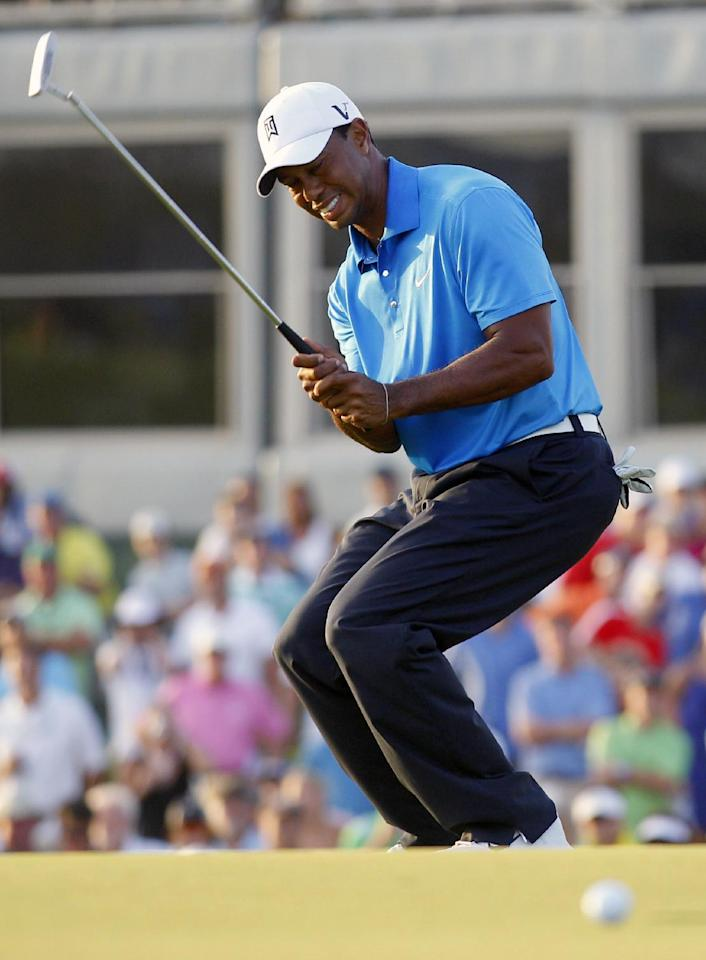 Tiger Woods reacts to his missed putt on the 18th green during the second round of the PGA Championship golf tournament on the Ocean Course of the Kiawah Island Golf Resort in Kiawah Island, S.C., Friday, Aug. 10, 2012. (AP Photo/Chuck Burton)