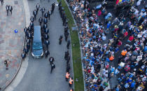 The hearse carrying the casket of Diego Maradona leaves the government house in Buenos Aires, Argentina, Thursday, Nov. 26, 2020. The Argentine soccer great who was among the best players ever and who led his country to the 1986 World Cup title died from a heart attack at his home Wednesday at the age of 60. (AP Photo/Mario De Fina)