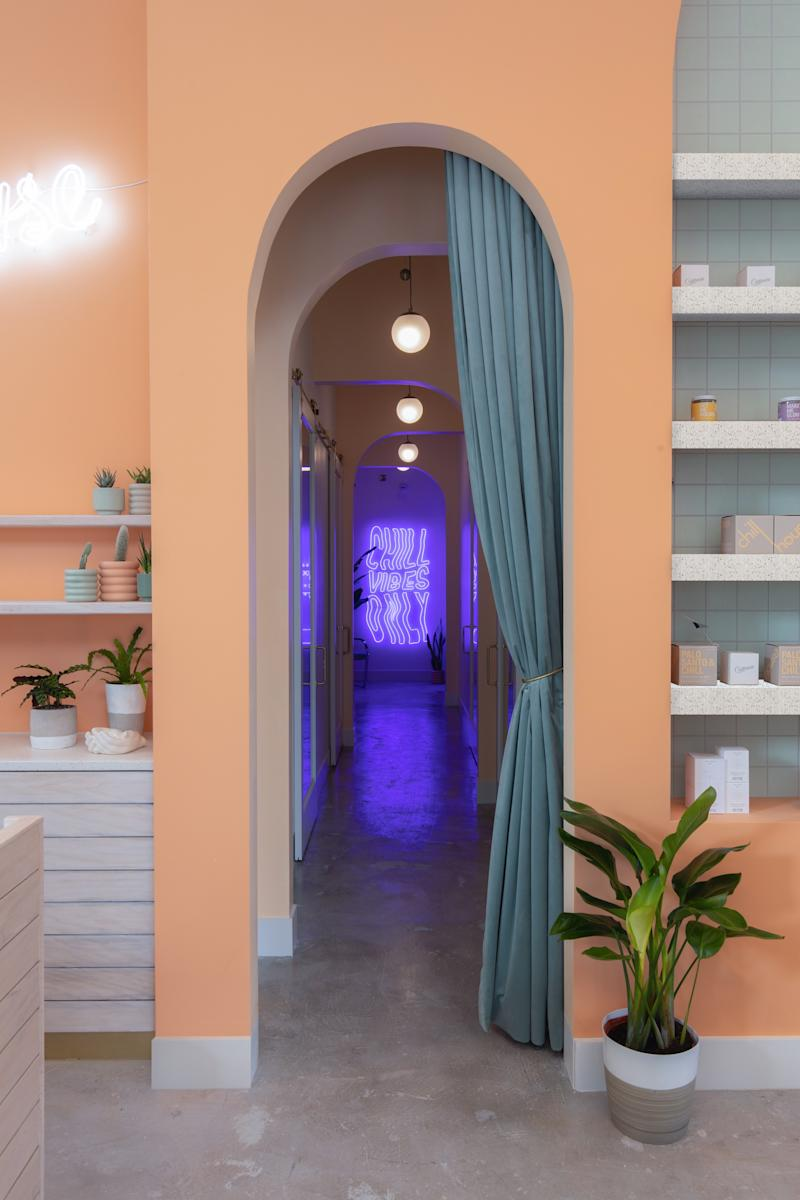 A hallway off of the entryway leads to treatment rooms for massages, facials, and an infrared sauna.