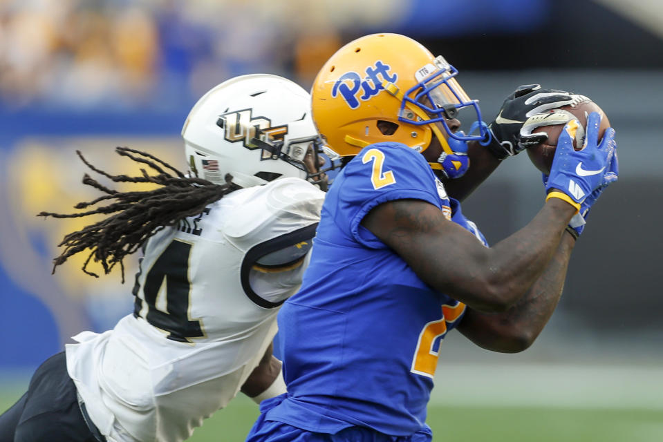 Central Florida defensive back Nevelle Clarke (14) breaks ups a pass tp Pittsburgh wide receiver Maurice Ffrench (2) during the second half of an NCAA college football game, Saturday, Sept. 21, 2019, in Pittsburgh. (AP Photo/Keith Srakocic)