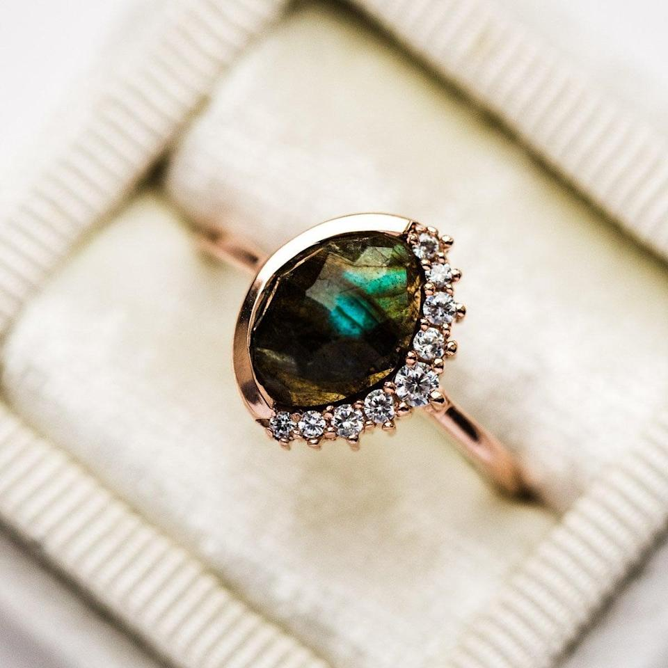 """<p>The labradorite stone on the <a href=""""https://www.popsugar.com/buy/Anni-Labradorite-Pave-Crescent-Ring-531215?p_name=Anni%20Labradorite%20Pave%20Crescent%20Ring&retailer=localeclectic.com&pid=531215&price=140&evar1=fab%3Aus&evar9=44555978&evar98=https%3A%2F%2Fwww.popsugar.com%2Fphoto-gallery%2F44555978%2Fimage%2F47011764%2FAnni-Labradorite-Pave-Crescent-Ring&list1=wedding%2Cjewelry%2Crose%20gold%2Cengagement%20rings&prop13=api&pdata=1"""" rel=""""nofollow noopener"""" class=""""link rapid-noclick-resp"""" target=""""_blank"""" data-ylk=""""slk:Anni Labradorite Pave Crescent Ring"""">Anni Labradorite Pave Crescent Ring</a> ($140) changes color in different light settings.</p>"""