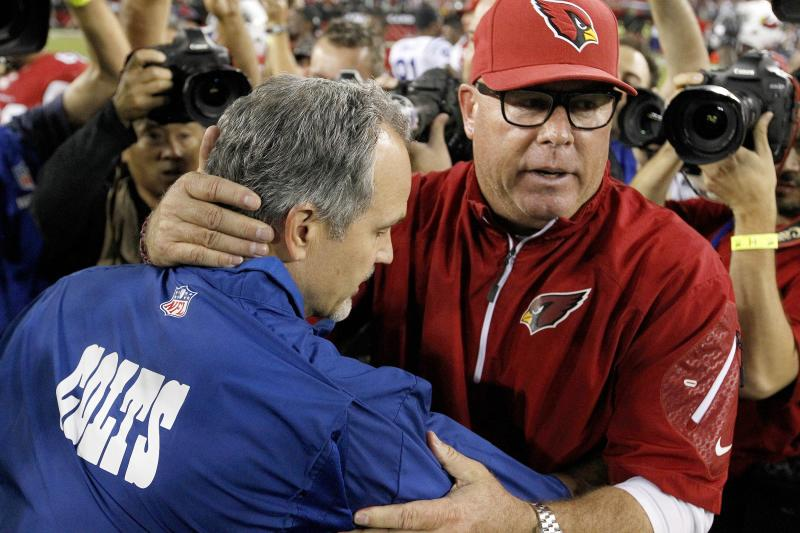 Arizona Cardinals head coach Bruce Arians, right, and Indianapolis Colts head coach Chuck Pagano embrace after an NFL football game Sunday, Nov. 24, 2013, in Glendale, Ariz. The Cardinals defeated the Colts 40-11. (AP Photo/Ross D. Franklin)