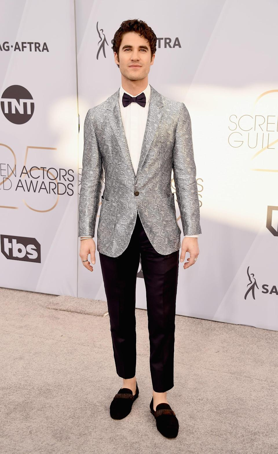 <p>Wearing an Emporio Armani suit, with David Yurman jewelry, and Christian Louboutin loafers.</p>