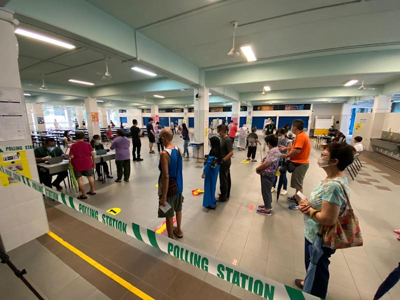 Queuing to vote at Dunearn Secondary School, while observing safe distancing in Singapore's GE2020. (Photo: Dhany Osman)