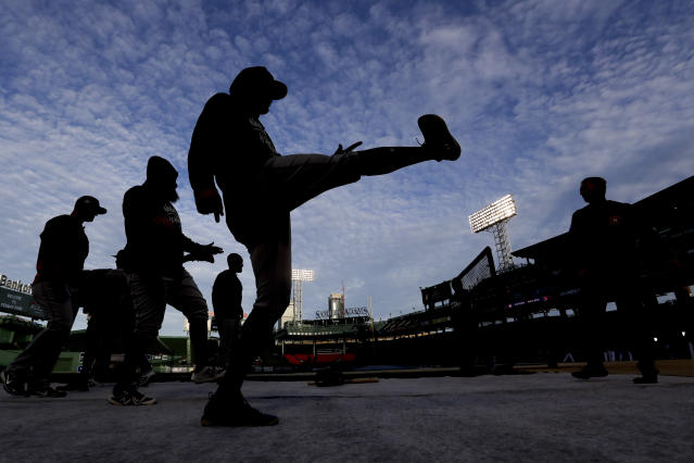 Members of the Houston Astros warm up during batting practice before Game 2 of a baseball American League Championship Series against the Boston Red Sox on Sunday, Oct. 14, 2018, in Boston. (AP Photo/David J. Phillip)