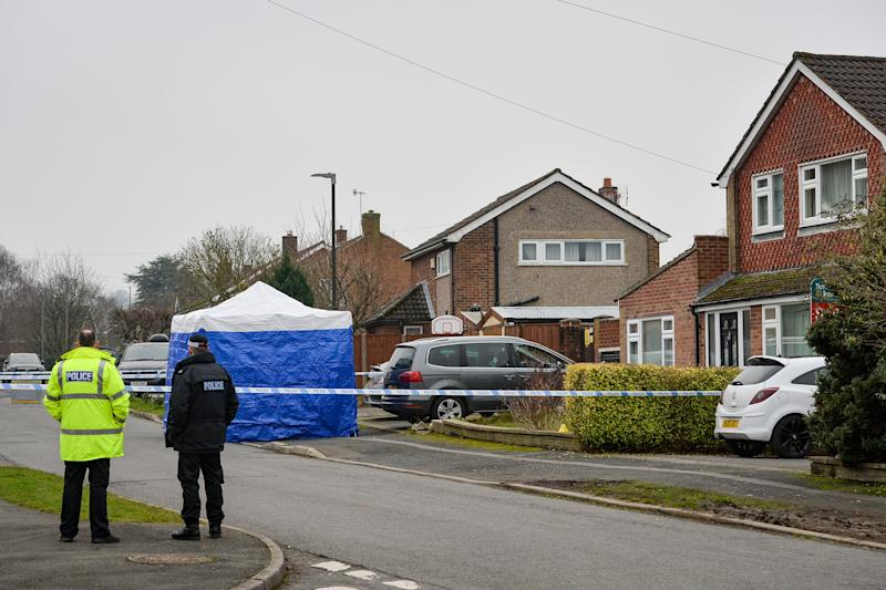 NUMBER PLATE PIXELATED BY PA PICTURE DESK Police at the scene in Duffield, Derbyshire after two people were found dead in a house.