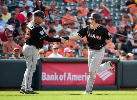 Jun 16, 2018; Baltimore, MD, USA; Miami Marlins catcher J.T. Realmuto (11) celebrates with third base coach Fredi Gonzalez (33) after hitting a home run in the third inning again the Baltimore Orioles at Oriole Park at Camden Yards. Mandatory Credit: Evan Habeeb-USA TODAY Sports