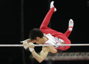 Japanese gymnast Kazuhito Tanaka slips while performing on the horizontal bar during the Artistic Gymnastics men's qualification at the 2012 Summer Olympics, Saturday, July 28, 2012, in London. (AP Photo/Gregory Bull)