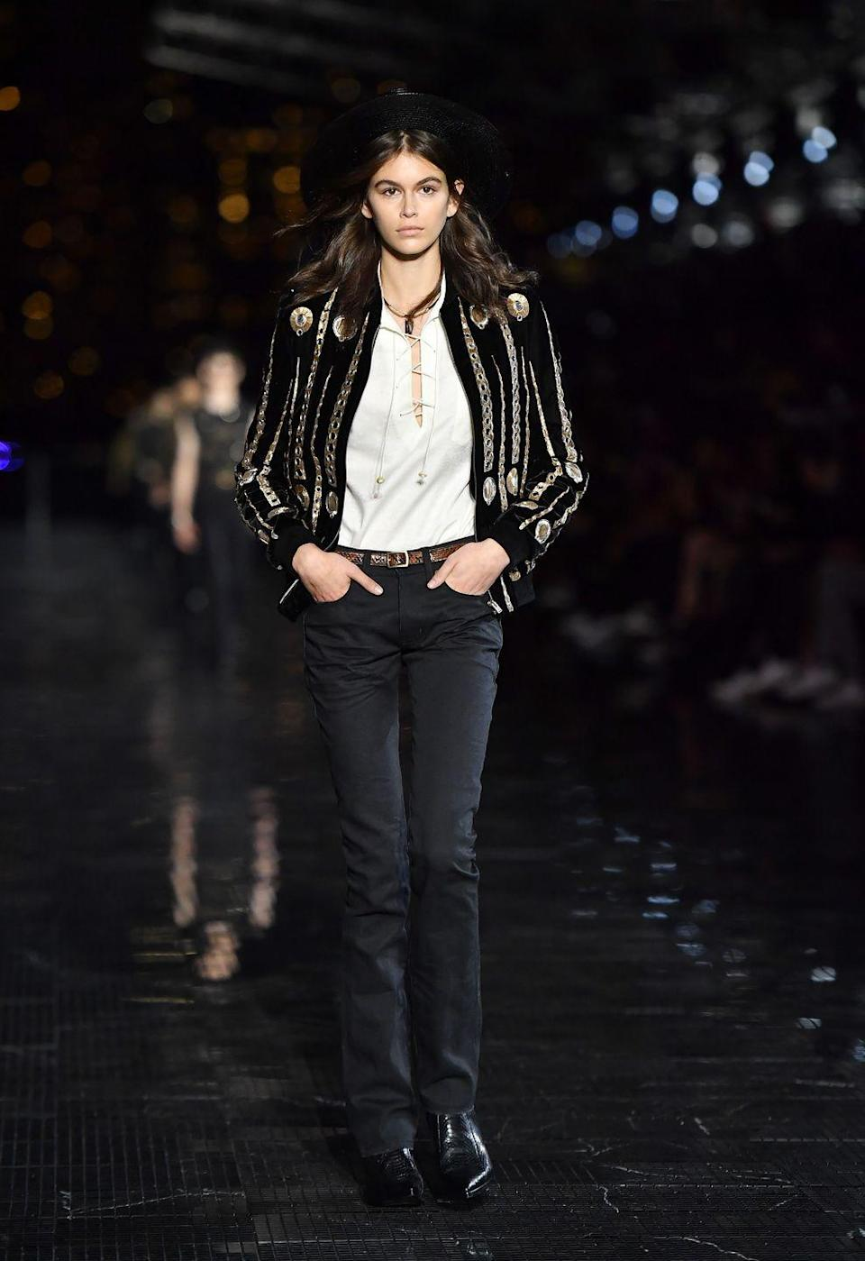 <p>The Californian beauty wore a black blazer, white shirt and jeans for the Saint Laurent Men's SS19 show in New Jersey, June 2018</p>