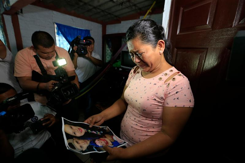 SAN MARTIN, El Salvador – Rosa Ramirez cries when shown a photograph printed from social media of her son Óscar Alberto Martínez Ramírez, 25, granddaughter Valeria, nearly 2, and her daughter-in-law Tania Vanessa Avalos, 21, while speaking to journalists at her home in San Martin, El Salvador, Tuesday, June 25, 2019.