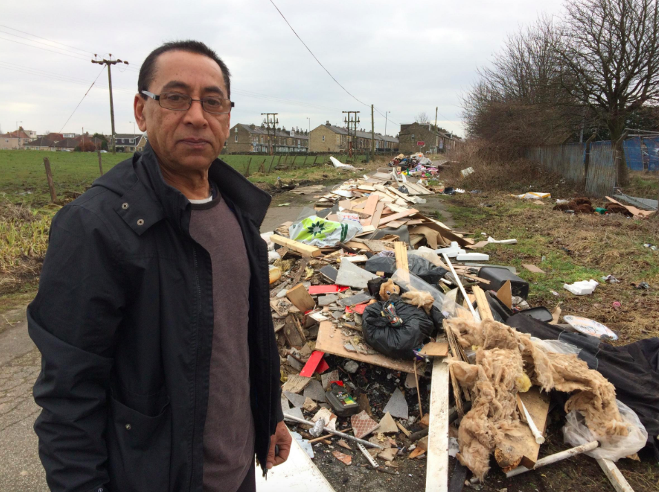 <em>Mohammed Khan obtained video footage of a white tipper truck dumping rubbish near the entrance to the road (SWNS)</em>