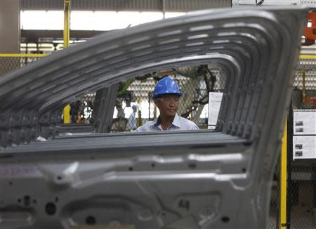 File photo of an employee working at an assembly line at the new Ford Thailand manufacturing plant located in Rayong province