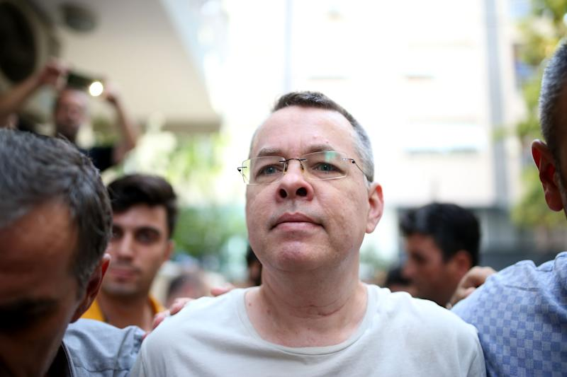 Pastor Andrew Brunson at centre of US-Turkey dispute begins journey home