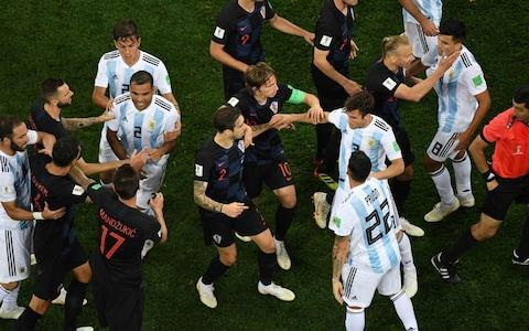 Croatia's players argue with Argentina's players after a foul on Croatia's midfielder Ivan Rakitic - Credit: KIRILL KUDRYAVTSEV/AFP/Getty Images