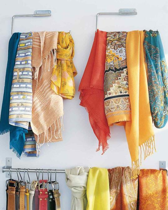 <p>Kitchen organization tools can work for the closet too. A wall-mounted paper-towel holder works great for hanging belts, and utensil rails are perfect for scarves and ties.</p>