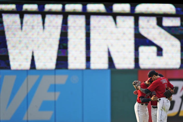 Cleveland Indians' Bradley Zimmer, Oscar Mercado, and Myles Straw hug after they defeated the Los Angeles Angels in a baseball game, Saturday, Aug. 21, 2021, in Cleveland. (AP Photo/Tony Dejak)