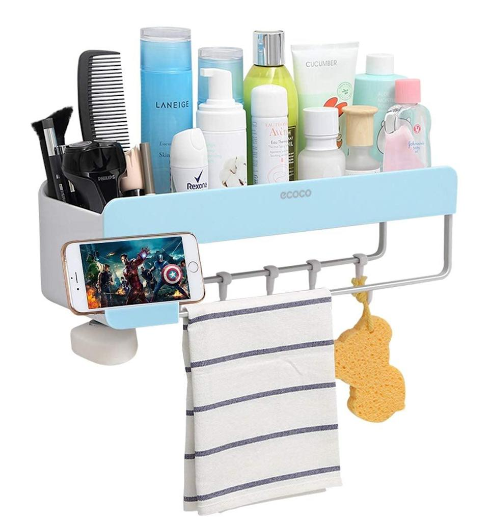 "<p>How cool is this <a href=""https://www.popsugar.com/buy/Adhesive-Bathroom-Shelf-Storage-Organizer-440474?p_name=Adhesive%20Bathroom%20Shelf%20Storage%20Organizer&retailer=amazon.com&pid=440474&price=29&evar1=casa%3Aus&evar9=47251564&evar98=https%3A%2F%2Fwww.popsugar.com%2Fhome%2Fphoto-gallery%2F47251564%2Fimage%2F47251628%2FAdhesive-Bathroom-Shelf-Storage-Organizer&list1=cleaning%2Corganization%2Cspring%20cleaning%2Csmall%20space%20living%2Cbathrooms%2Chome%20organization&prop13=mobile&pdata=1"" class=""link rapid-noclick-resp"" rel=""nofollow noopener"" target=""_blank"" data-ylk=""slk:Adhesive Bathroom Shelf Storage Organizer"">Adhesive Bathroom Shelf Storage Organizer </a> ($29)? There's even a place for your phone.</p>"
