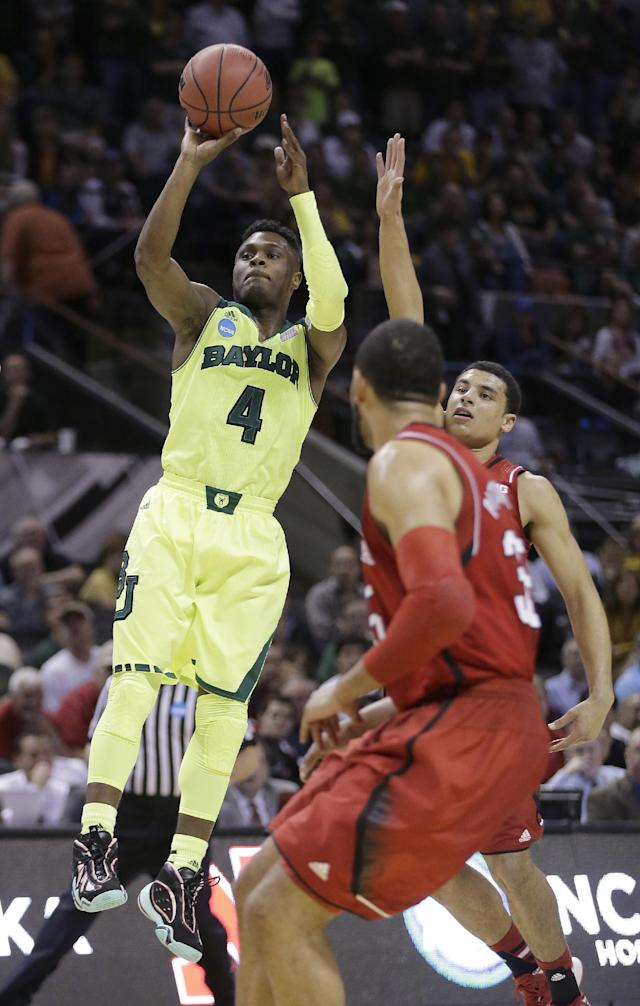 Baylor's Gary Franklin (4) shoots against Nebraska during the first half of a second-round game in the NCAA college basketball tournament Friday, March 21, 2014, in San Antonio. (AP Photo/Eric Gay)