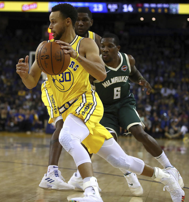7160ede0 Curry injured, Bucks snap Warriors' 8-game win streak