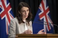 New Zealand Prime Minister Jacinda Ardern reacts during a press conference in Wellington, New Zealand, Friday, Aug. 14, 2020. Ardern announced that the three-day lockdown in Auckland would be extended by another 12 days at level 3, the rest of New Zealand will stay at level 2 restrictions as health authorities investigate the source of the first domestic coronavirus outbreak in more than three months. (Mark Mitchell/New Zealand Herald via AP)
