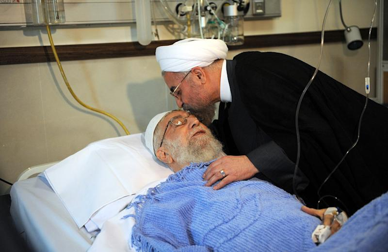 Iranian President Hassan Rouhani visits Iran's supreme leader Ayatollah Ali Khamenei at a hospital in Tehran on September 8, 2014 after Khamenei's prostate operation (AFP Photo/)