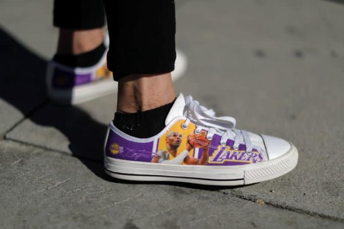 Kobe Bryant's fans gather at a memorial outside the Staples Center in Los Angeles
