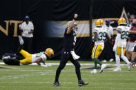 New Orleans Saints quarterback Drew Brees (9) celebrates after throwing a touchdown pass to wide receiver Emmanuel Sanders in the first half of an NFL football game against the Green Bay Packers in New Orleans, Sunday, Sept. 27, 2020. (AP Photo/Brett Duke)