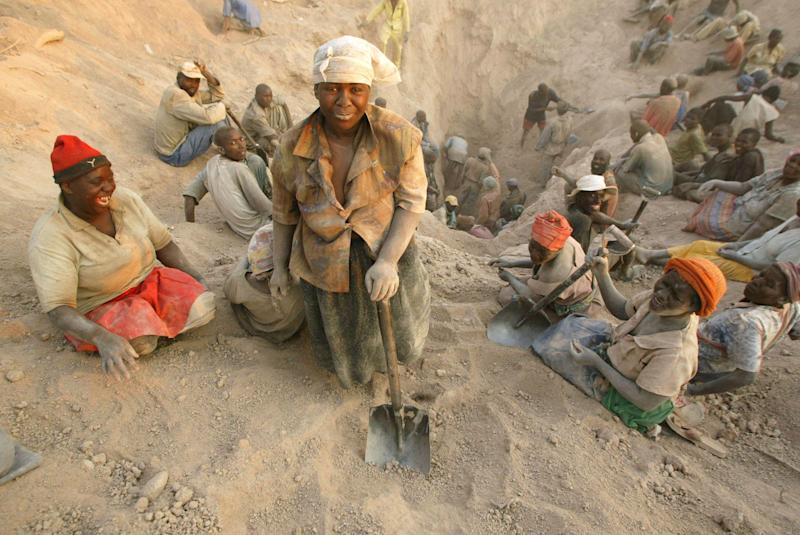 File - in this file photo taken Wednesday, Nov. 1, 2006 gangs of illegal miners dig for diamonds in Marange, eastern Zimbabwe. The wealth enjoyed by just a few comes, at least in part, from the vast Marange diamond field that was exposed by an earth tremor in 2006. The Marange deposit is the biggest diamond field found in Africa for a century, estimated to be worth some billions of dollars, but as most Zimbabweans remain mired in poverty, questions are being asked about where all the money went and who benefited. (AP Photo/Tsvangirayi Mukwazhi, FILE)