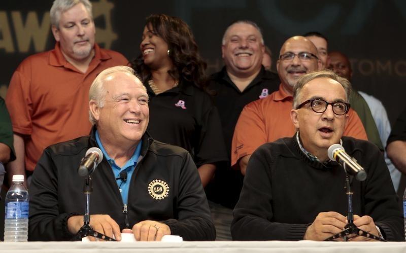 United Auto Workers (UAW) President Dennis Williams and FCA CEO Sergio Marchionne hold a news conference to announce a tentative agreement between the UAW and FCA US LLC in Detroit,