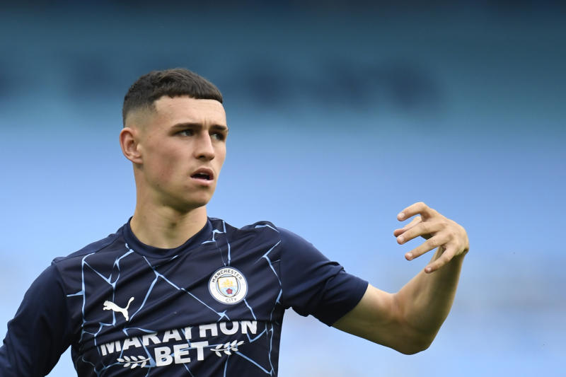 Manchester City's Phil Foden warms up before the Champions League, round of 16, second leg soccer match between Manchester City and Real Madrid at the Etihad Stadium stadium in Manchester, England, Friday, Aug. 7, 2020. (Peter Powell/Pool Photo via AP)