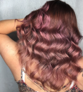 """<p>Rose gold tones were another extreme color highlight of 2017, but heavy metal shades like these are expected to get warmer in 2018. McGowan Hansen's favorite vivid metallic shades include rose metallic, as it's a deeper variation of the predictable aformentioned shade.<br>Given that rose gold tones universally flatter all skin tones, it's safe for both blondes and brunettes to pull off rose metallic looks. Just be sure to schedule a consultation with your colorist in order to decide how this look will work for your skin tone.<br>""""Rose metallic shades look and feel like actual rose gold,"""" she says. """"This stunning color can be incorporated in brunette color schemes and can also give dimension and tone to blondes."""" (Photo: Instagram/laurachristopherhairartist) </p>"""