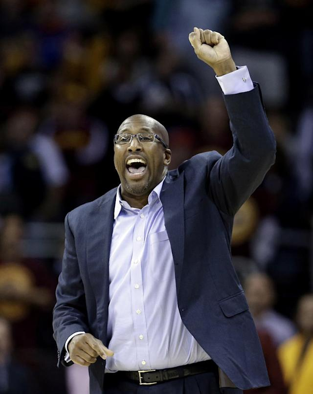 Cleveland Cavaliers head coach Mike Brown reacts in the fourth quarter of an NBA basketball game against the Brooklyn Nets, Wednesday, Oct. 30, 2013, in Cleveland. The Cavaliers won 98-94. (AP Photo/Tony Dejak)