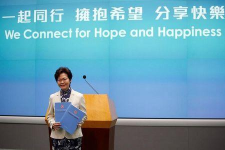FILE PHOTO - Hong Kong Chief Executive Carrie Lam poses with copies of her policy speech in Hong Kong, China October 11, 2017.      REUTERS/Bobby Yip/File Photo