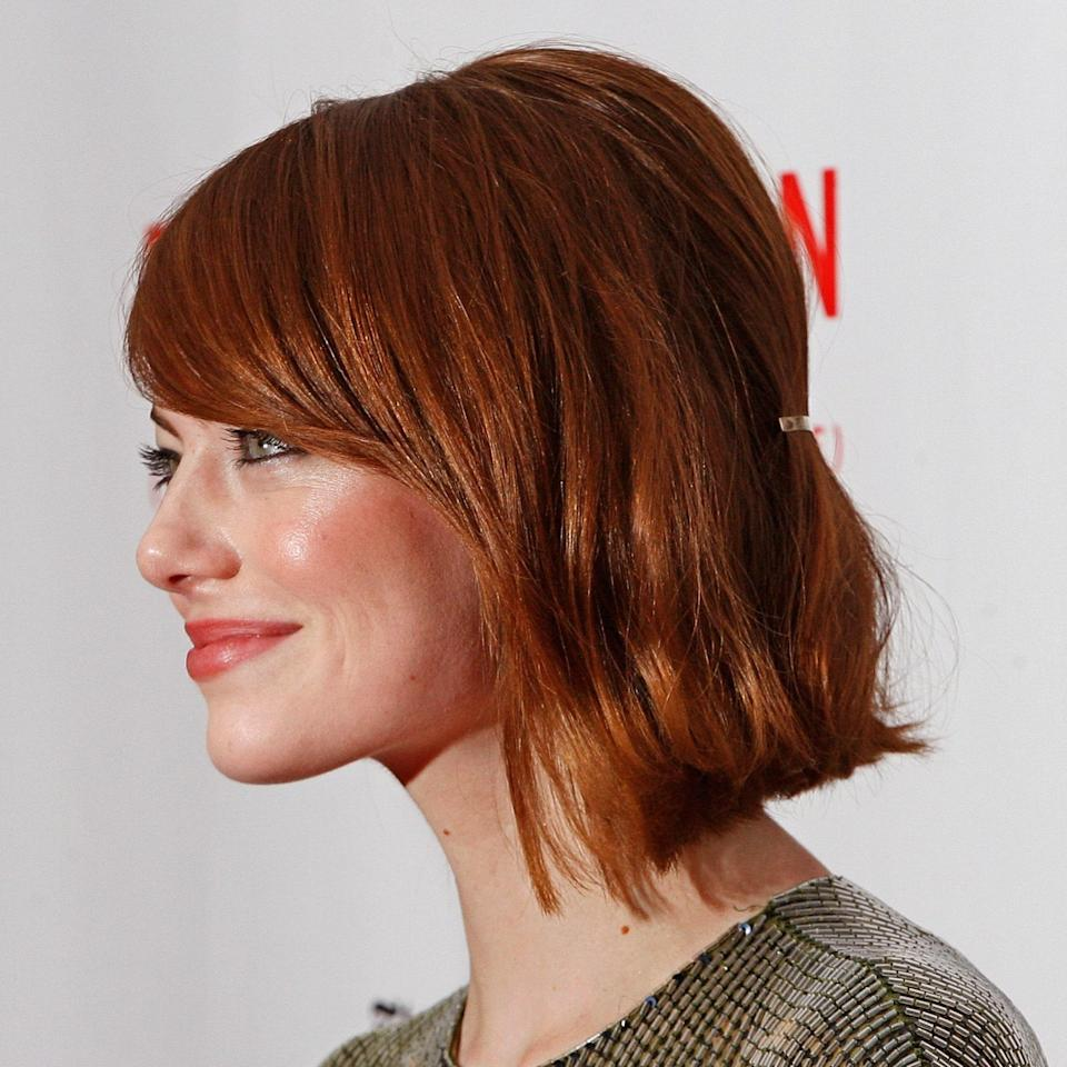 """Since some short haircuts can be difficult to put into a bun or ponytail, dress it up with an accessory like Emma Stone does here. """"Using a clip to pin your hair back is an easy way to turn your everyday bob into a quick evening look,"""" says hairstylist <a href=""""https://www.instagram.com/ryanrichman/?hl=en"""" rel=""""nofollow noopener"""" target=""""_blank"""" data-ylk=""""slk:Ryan Richman"""" class=""""link rapid-noclick-resp"""">Ryan Richman</a>. """"A hair accessory from <a href=""""https://shop-links.co/1745738338847037465"""" rel=""""nofollow noopener"""" target=""""_blank"""" data-ylk=""""slk:Lelet NY"""" class=""""link rapid-noclick-resp"""">Lelet NY</a> or <a href=""""https://shop-links.co/1745738382836065895"""" rel=""""nofollow noopener"""" target=""""_blank"""" data-ylk=""""slk:Jennifer Behr"""" class=""""link rapid-noclick-resp"""">Jennifer Behr</a> can give your short style the elegance you want for your wedding day."""""""