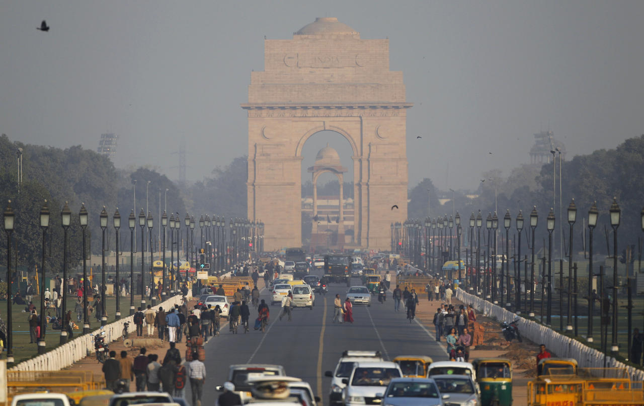 In this Thursday, Dec. 15, 2011 photo, India Gate, the war memorial, is seen through haze in New Delhi, India. A decade ago, plans for a metro and clean-fuel buses were hailed as New Delhi's answer to pollution. But air in the Indian capital is as dirty as ever - partly because its continued development has brought skyrocketing use of cars. (AP Photo/Saurabh Das)