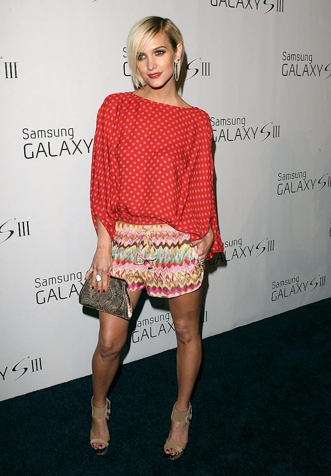 Call us crazy, but we not-so-secretly love the casual getup Ashlee Simpson threw on for a recent Samsung soiree in Beverly Hills. In addition to a killer coif, the hot mama donned a polka dot blouse and drawstring shorts from Haute Hippie. Ash's awesome accessories included metallic hoop earrings, a gold clutch, cocktail ring, and nude sandals. Truth be told, this may be the best she's ever looked! Discuss. (6/21/2012)