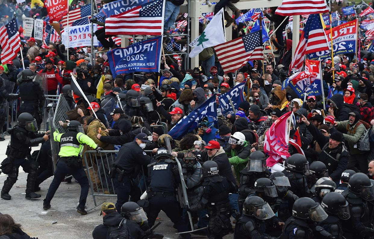 Trump supporters clash with police and security forces as they push barricades to storm the U.S. Capitol in Washington D.C on January 6, 2021.  (Roberto Schmidt/AFP via Getty Images)