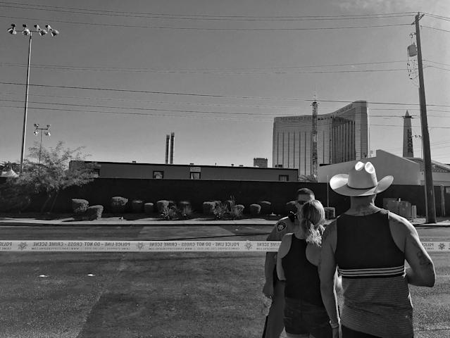 A couple speaks to a Las Vegas police officer guarding the perimeter of the Route 91 festival site Monday in Las Vegas. (Photo: Holly Bailey/Yahoo News)