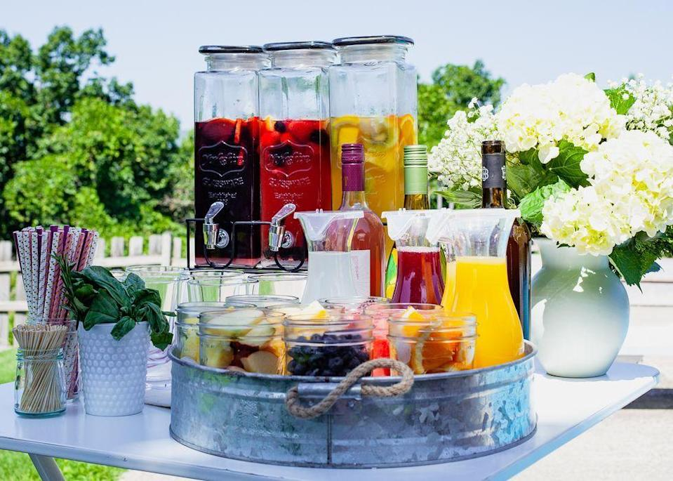 "<p>Sangria is equal parts festive and refreshing. So, it's only fitting to make the beverage part of your 50th soiree. </p><p><a class=""link rapid-noclick-resp"" href=""https://go.redirectingat.com?id=74968X1596630&url=https%3A%2F%2Fwww.walmart.com%2Fip%2FBlood-Orange-Sangria-Wine-Making-Kit-by-Island-Mist%2F174023656&sref=https%3A%2F%2Fwww.thepioneerwoman.com%2Fhome-lifestyle%2Fentertaining%2Fg34192298%2F50th-birthday-party-ideas%2F"" rel=""nofollow noopener"" target=""_blank"" data-ylk=""slk:SHOP SANGRIA-MAKING KITS"">SHOP SANGRIA-MAKING KITS</a></p>"