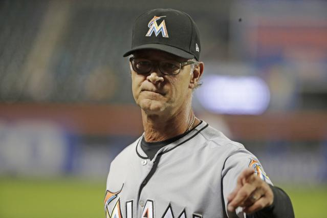 Miami Marlins manager Don Mattingly gestures after a pitching change during the seventh inning of a baseball game against the New York Mets, Tuesday, Sept. 11, 2018, in New York. (AP Photo/Frank Franklin II)