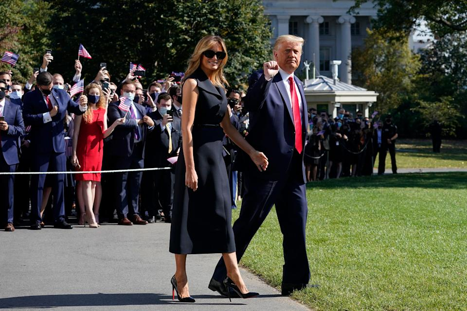 President Donald Trump and first lady Melania Trump walk to board Marine One on the South Lawn of the White House on Thursday. Trump is headed to Nashville, Tennessee, for a debate with Joe Biden.