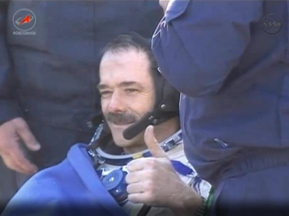 Canadian astronaut Chris Hadfield gives a thumb's up sign after successfully returning to Earth on May 14, 2013 (May 13 EDT) aboard a Soyuz space capsule following a five month mission. Hadfield commanded the Expedition 35 mission to the Intern
