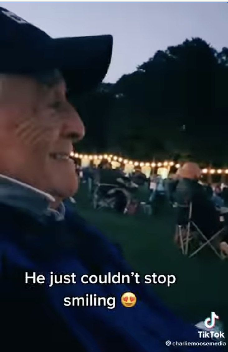 Man watching The Greatest Showman