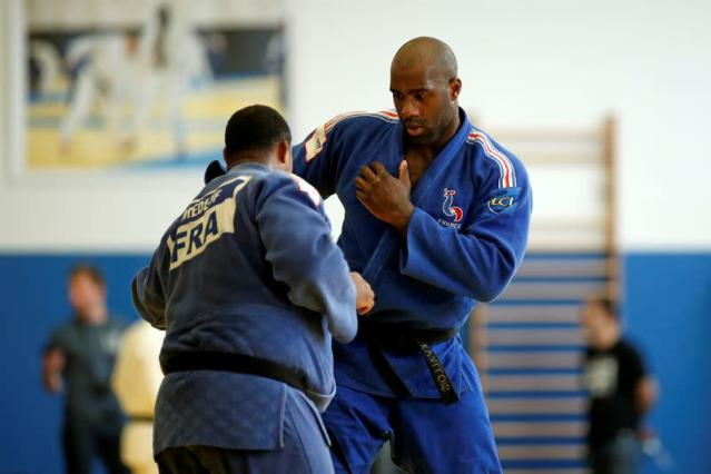 FILE PHOTO: French judoka Teddy Riner, named France's flag-bearer for Rio 2016 Olympics, takes part in a training session at the French National Institute of Sport and Physical Education (INSEP) in Paris