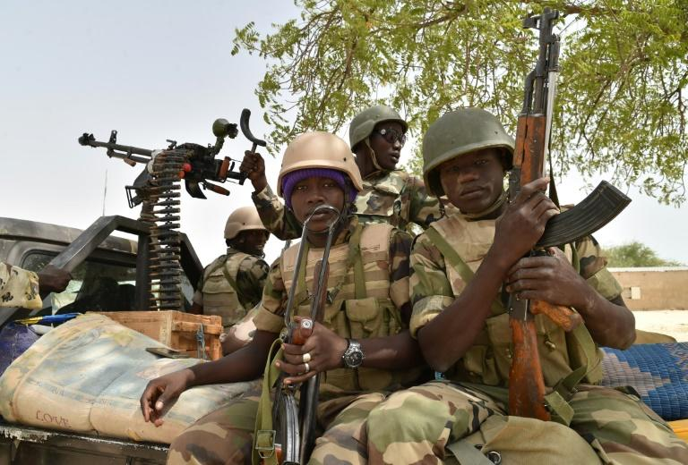 A military coalition is battling Boko Haram in a region crisscrossed by militant groups and traffickers competing for money and influence (AFP Photo/ISSOUF SANOGO)